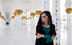 Beautiful Woman at the Grand Mosque in Abu Dhabi. Travel. Beauty Fashion Portrait