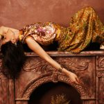 portrait of beauty sensual young woman in oriental style in luxury room
