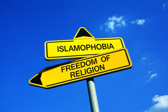Islamophobia or Freedom of Religion - Traffic sign with two options - appeal to fight against xenophobia and negative prejudice against islam. Respect and tolerance towards muslims