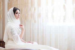 beautiful caucasian bride in traditional dress