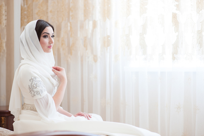 beautiful caucasian bride in traditional dress