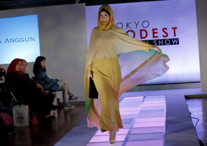 A model presents a creation by brand Alia Anggun during Tokyo Modest Fashion Show, Muslim fashion show, at Halal Expo Japan in Tokyo, Japan, November 22, 2016.   REUTERS/Toru Hanai