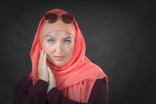 Studio Muslim woman with black background
