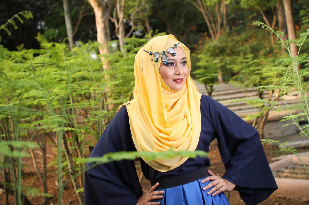 high fashion muslim women posing at wooden background
