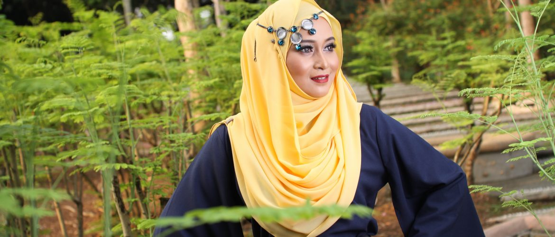 high fashion muslim women posing at wooden background
